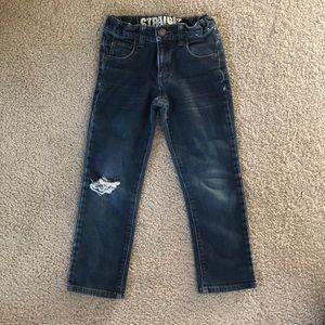Distressed straight legged jeans